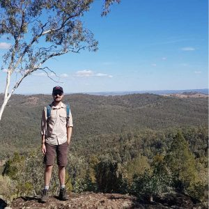 Man standing on rock in bushland