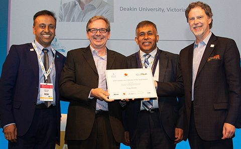 Craig Woods receives award for 35 years of contact lens education
