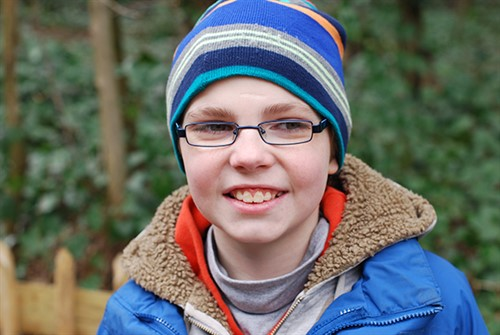 Happy boy with autism with new glasses - online